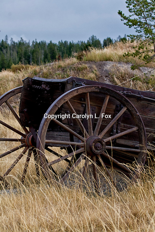 An old wagon sits in a field in Montana.