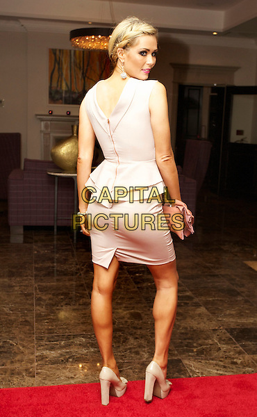 Nicola McLean .Caroline's Campaign Valentine Party at Rydges Hotel, Kensington, London, England..February 6th, 2012.full length white dress peplum looking over shoulder back behind rear .CAP/CB/PP.©CB/PP/Capital Pictures.