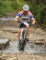 NWA Democrat-Gazette/ANDY SHUPE<br /> Steven Wall of Eldorado rides across Lee Creek Saturday, Sept. 19, 2015, during the Northwest Arkansas Mountain Bike Championships at Devil's Den State park.