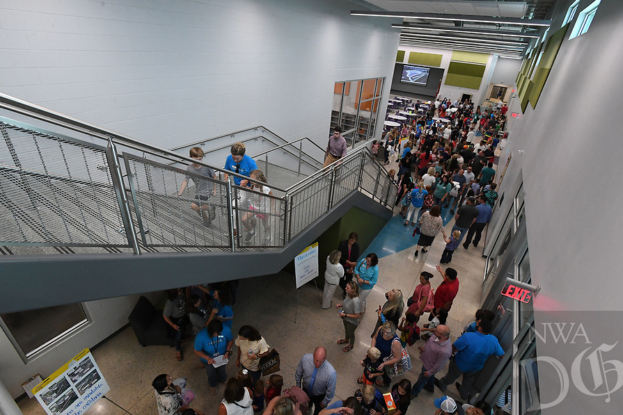NWA Democrat-Gazette/J.T. WAMPLER Students, parents, teachers and guests take a look around Wednesday August 7, 2019 after the ribbon cutting ceremony at Fairview Elementary School, the Rogers School DistrictÕs 16th elementary school.