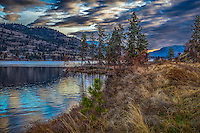 Fine Art Print Mountain and Lake Scenic of  reflections on Skaha Lake in BC Canada during the late fall season with all of it glowing colours.ocean waves crashing onto the rocks of the beach.