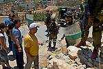 Israeli, International & Palestinian protesters attempt to pass a road block during a demonstration against Israel's controversial separation barrier in the West Bank town of Beit Jala near Bethlehem on 04/07/2010.