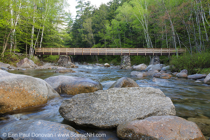 Foot bridge along the Lincoln Woods Trail which crosses Franconia Brook in Lincoln, New Hampshire. Hikers enter into the Pemigewasset Wilderness on the righthand side of this bridge. Old abutments from Trestle 7 of the East Branch & Lincoln Railroad (1893-1948) are used to support this foot bridge.