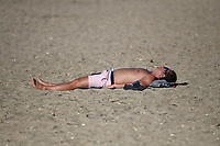 1st April 2020, Kohi Beach, Auckland, New Zealand;  Sunbathing in the warm weather during the lockdown due to Covid-19. Kohimarama, Auckland, New Zealand on Wednesday 1 April 2020.