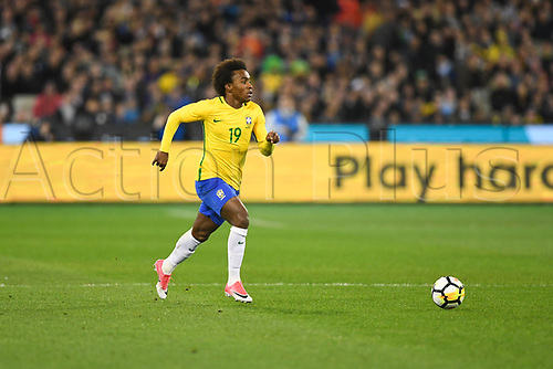 June 9th 2017, Melbourne Cricket Ground, Melbourne, Australia; International Football Friendly; Brazil versus Argentina; Willian Silva of Brazil looks up as he runs towards goal