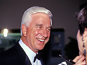 Actor Leslie Nielson is interviewed by a reporter as he arrives for the State Dinner hosted by United States President George H.W. Bush and first lady Barbara Bush honoring President Václav Havel of Czechoslovakia at the White House in Washington, DC on October 22, 1991.<br /> Credit: Ron Sachs / CNP
