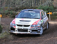 Fraser Wilson - Jane Nicol in a Mitsubishi Evolution 9 competing at Junction 6 on the Munro Scotch Beef Millbuie Special Stage 1 on the 2014 Arnold Clark/Thistle Hotel Snowman Rally, supported by Highland Office Equipment, part of Capital Document Solutions which was organised by Highland Car Club and based in Inverness on 22.2.14; Round 1 of the 2014 RAC MSA Scottish Rally Championship sponsored by ARR Craib Transport Limited.