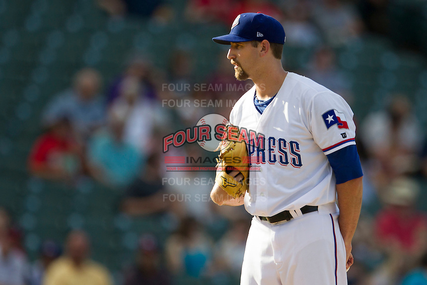 Round Rock Express starting pitcher Michael Kirkman (50) looks to his catcher for the sign against the Oklahoma City RedHawks during the Pacific Coast League baseball game on August 25, 2013 at the Dell Diamond in Round Rock, Texas. Round Rock defeated Oklahoma City 9-2. (Andrew Woolley/Four Seam Images)