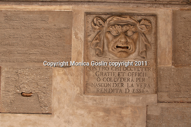 Architectual detail in the Doge's Palace in Venice, Italy where votes were placed in the mouth of the face on the wall