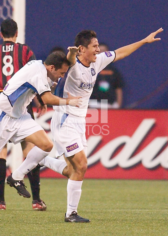 Brian Ching of the Earthquakes celebrates scoring a goal with Ramiro Corrales. The San Jose Earthquakes and the the NY/NJ MetroStars played to a 4-4 tie on 7/02/03 at Giant's Stadium, NJ..