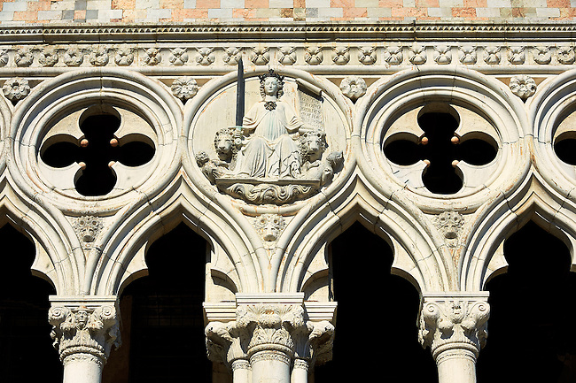 The 14th Century Gothic style architectural details of The Doge's Palace on St Marks Square, Palazzo Ducale, Venice Italy