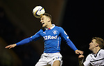 Dean Shiels jumps and flattens the ball with his head