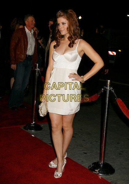 """KATE MARA.""""Shooter"""" Los Angeles Premiere held at Mann Village Theatre, Westwood, California, USA,.08 March 2007..full length white dress gold clutch bag shoes open toe Christian Louboutin snakeskin heels platforms red soles peeptoe hand on hip.CAP/ADM/RE.©Russ Elliot/AdMedia/Capital Pictures."""