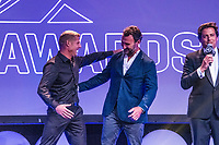 The Star, Broadbeach, Gold Coast Queensland/AUS (Sunday, March 31, 2019) Joe Turple (USA) interviews MIck Fanning (AUS) and Joel parkinson (AUS) - The world's best surfers were honored tonight at the formal black tie World Surf League (WSL) Awards, the event that celebrated the achievements of the 2018 season.<br /> <br /> The evening commemorated the newly crowned World Champions across the Championship Tour, Big Wave Tour, Longboard, Pro Junior, Masters, and Grand Masters. Recognition was also delivered to the best performances, most ground-breaking moments, and exciting achievements in surfing over this past year.<br /> <br /> 2018 WSL World Champions<br /> Championship Tour: Stephanie Gilmore (AUS), Gabriel Medina (BRA)<br /> Big Wave Tour: Keala Kennelly (HAW), Grant &lsquo;Twiggy&rsquo; Baker (ZAF)<br /> Longboard: Soleil Errico (USA), Steven Sawyer (ZAF)<br /> Pro Junior: Kirra Pinkerton (USA), Mateus Herdy (BRA)<br /> Masters: Layne Beachley (AUS), Rob Bain (AUS)<br /> Grand Masters: Dave Macaulay (AUS)<br /> 2018 Championship Tour Honors<br /> Fan Favorite Award pres. by Breitling: Tatiana Weston-Webb (BRA), Gabriel Medina (BRA)<br /> Wave of the Year: Carissa Moore (HAW), Gabriel Medina (BRA)<br /> Move of the Year: Carissa Moore (HAW), Filipe Toledo (BRA)<br /> Heat of the Year: Carissa Moore (HAW) vs. Courtney Conlogue (USA) at Beachwaver Maui Pro / Gabriel Medina (BRA) vs. Conner Coffin (USA) at Billabong Pipe Masters<br /> CT Runner-Ups: Lakey Peterson (USA), Julian Wilson (AUS)<br /> CT Rookies of the Year: Caroline Marks (USA), Wade Carmichael (AUS)<br />  Photo: joliphotos.com