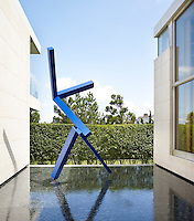 A 2007 bronze sculpture by Joel Shapiro in a reflecting pool outside the entry