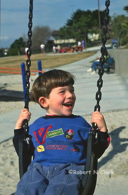 Boy on swing in the park