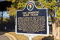 A historical marker summarizes the domestic slave trade in near Union Station in Montgomery, Alabama.