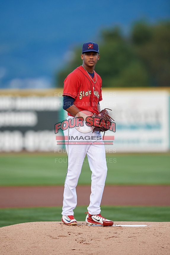 State College Spikes starting pitcher Diego Cordero (11) gets ready to deliver a pitch during a game against the West Virginia Black Bears on August 30, 2018 at Medlar Field at Lubrano Park in State College, Pennsylvania.  West Virginia defeated State College 5-3.  (Mike Janes/Four Seam Images)