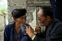 Two old men enjoy smoking in Dali, Yunnan, China.