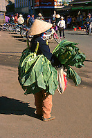 Dalat is known for its and produce, thanks to the fertile farmland nearby: cauliflower, artichokes and strawberries are abundant here. This vendor is displaying her fresh greens by wearing them outside the Dalat Market.