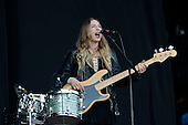 HAIM - Este Haim - performing live on the Pyramid Stage on Day One at the 2013 Glastonbury Festival held at Pilton Farm Pilton Somerset UK - 28 Jun 2013.  Photo credit: George Chin/IconicPix