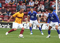 Michael Higdon closed down by Marouane Fellaini in the Motherwell v Everton friendly match at Fir Park, Motherwell on 21.7.12 for Steven Hammell's Testimonial.