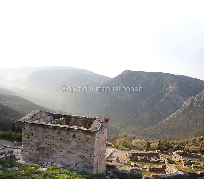 DELPHI, GREECE - APRIL 11 : A general view of the rear side of the Treasury of the Boeotians with the slopes of the Mount Parnassus in the distance, on April 11, 2007 in the Sanctuary of Apollo, Delphi, Greece. This small rectangular building with cella and pronaos was built at the beginning of the 1st century AD. (Photo by Manuel Cohen)