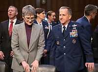 """United States Secretary of the Air Force Heather Wilson, left and US Air Force General David L. Goldfein, Chief of Staff of the Air Force, right, prior to giving testimony before the US Senate Committee on Armed Services prior to a hearing on """"Chain of Command's Accountability to Provide Safe Military Housing and Other Building Infrastructure to Service members and Their Families"""" on Capitol Hill in Washington, DC on Thursday, March 7, 2019.<br /> Credit: Ron Sachs / CNP/AdMedia"""