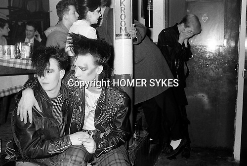 """Covent Garden, London. 1980 <br /> George O'Dowd, later know as Boy George, with friend Wilf Rogers at the Blitz Club, where George was working as the cloakroom attendant.  He is wearing a Malcolm McLaren cowboys t-shirt from Seditionaries based on a Jim French drawing.<br /> In reality George O'Dowd,had not assumed the name """"Boy George"""", at this time. He told me he was known as just George.<br /> Jim French (14 July 1932 - 16 June 2017) American photographer and illustrator."""