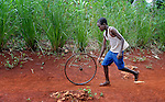 A boy rolls a wheel in Mizak, a small village in the south of Haiti.