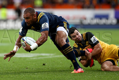 05.03.2016. Dunedin, New Zealand.  Patrick Osborne of the Highlanders in the tackle of James Marshall of the Hurricanes in the Super Rugby match between Highlanders and Hurricanes, Forsyth Barr Stadium, Dunedin, Saturday, March 05, 2016.