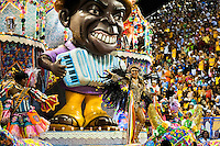 Dancers of Portela samba school perform on a float during the Carnival parade at the Sambadrome in Rio de Janeiro, Brazil, 20 February 2012. The Carnival in Rio de Janeiro, considered the biggest carnival in the world, is a colorful, four day celebration, taking place every year forty days before Easter. The Samba school parades, featuring thousands of dancers, imaginative costumes and elaborate floats, are held on the Sambadrome, a purpose-built stadium in downtown Rio. According to costumes, flow, theme, band music quality and performance, a single school is declared the winner of the competition.