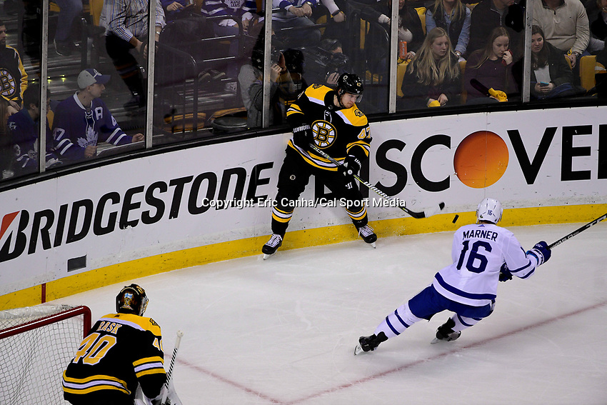 April 21, 2018: Boston Bruins defenseman Torey Krug (47) passes the puck during game five of the first round of the National Hockey League's Eastern Conference Stanley Cup playoffs between the Toronto Maple Leafs and the Boston Bruins held at TD Garden, in Boston, Mass. Toronto defeats Boston 4-3, Boston leads Toronto 3 games to 2 in the best of 7 series.