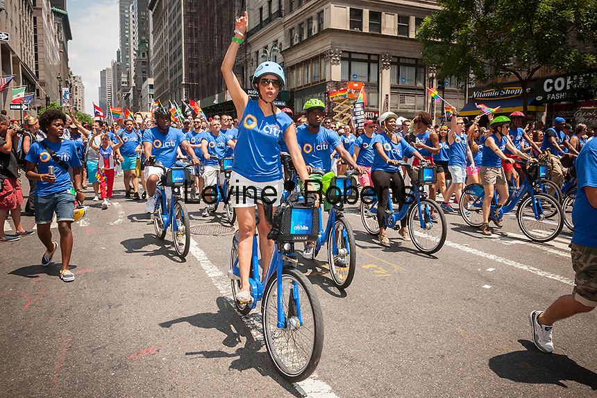 Citicorp workers ride CitiBikes in the the 44th annual Lesbian, Gay, Bisexual and Transgender Pride Parade on Fifth Avenue in New York on Sunday, June 30, 2013. The turn out for the parade was especially large with the recent Supreme Court decision overturning the Defense of Marriage Act (DOMA) and California's Proposition 8.  (© Richard B. Levine)