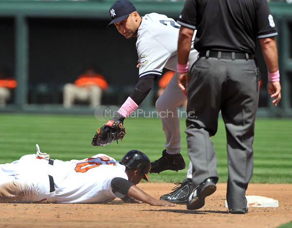 Baltimore, MD - May 10, 2009 -- Baltimore Oriole center fielder Adam Jones (10) is tagged out by New York Yankee shortstop Derek Jeter (2) after Nick Markakis (not pictured) walked in the third inning against the Baltimore Orioles at Oriole Park at Camden Yards in Baltimore, MD on Sunday, May 10, 2009..Credit: Ron Sachs / CNP./MediaPunch (RESTRICTION: NO New York or New Jersey Newspapers or newspapers within a 75 mile radius of New York City)