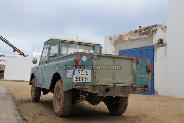 Spain, Canary Islands, Archipielago Chinijo, Isla Graciosa, Caleta del Sebo. Land Rover Santana 109 4-cyl Truck Cab. --- No releases available. Automotive trademarks are the property of the trademark holder, authorization may be needed for some uses.
