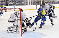 Delaware's Pierce Lamberton (39) looses the puck in his skates as he tries to skate around Navy goalie Thatcher Givens (30). Delaware defeated Navy 8-3 at McMullen Hockey Arena.<br /> <br /> Photo by Randy Litzinger
