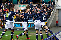 Shaun Williams of Millwall (right) celebrates with his team mates after scoring the opening goal in the first minute during the Sky Bet Championship match between Millwall and Nottingham Forest at The Den, London, England on 30 March 2018. Photo by Alan  Stanford / PRiME Media Images.