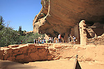 Visitors at Spruce Tree House ruins, Mesa Verde National Park, Colorado, USA