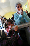 ROMa people pray during a Sunday service at the Pentecostal church in Barbulesti, Romania. 15 years ago, the population of Barbulesti, a village situated in the south of Romania and inhabited mostly by ROMa people, started to convert to the Pentecostal Church. Believers say that conversion led to a decrease in crime in the area, although official statistics do not confirm it.