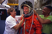 United States Senator John H. Glenn Jr. (Democrat of Ohio), is assisted by suit experts Jean Alexander and Carlous Gillis prior to a training session at the Johnson Space Center (JSC) in Houston, Texas on April 28, 1998. The STS-95 crew members are getting prepared for a scheduled Oct. 29 launch aboard the Space Shuttle Discovery. .Credit: Joe McNally, National Geographic / NASA via CNP