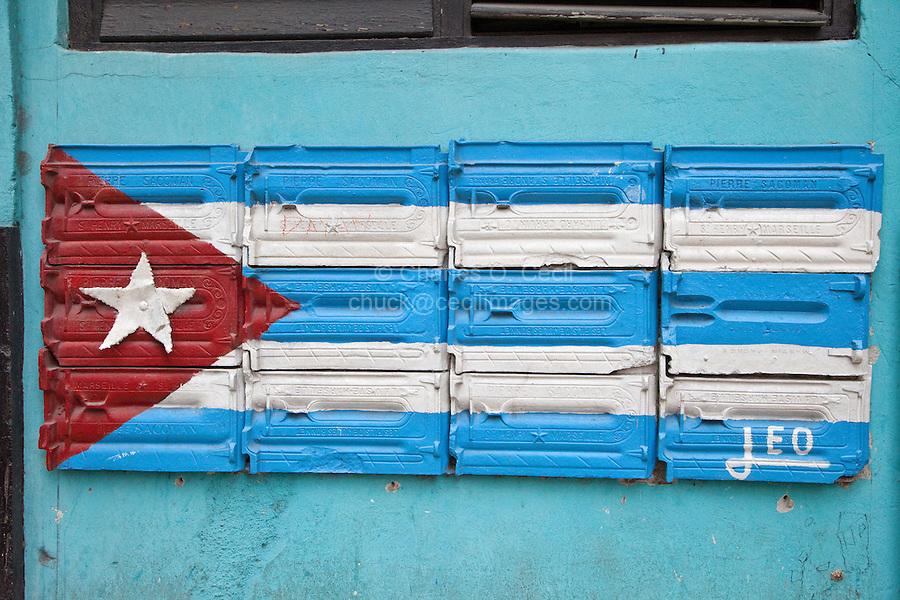 Cuba, Havana.  Cuban Flag Painted On Side of Building as Decoration, Central Havana.