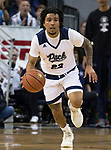 Nevada guard Jazz Johnson (22) brings the ball up the court against Utah State in the first half of an NCAA college basketball game in Reno, Nev., Wednesday, Jan. 2, 2019. (AP Photo/Tom R. Smedes)