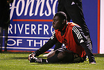 20 March 2004: Fourteen year old Freddy Adu watches the game while stretching on the sideline during the first half. DC United of Major League Soccer defeated the Charleston Battery of the A-League 2-1 at Blackbaud Stadium in Charleston, SC in a Carolina Challenge Cup match..
