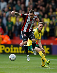 Nathan Thomas of Sheffield Utd jumps over Time Klose of Norwich City during the Championship match at Bramall Lane Stadium, Sheffield. Picture date 16th September 2017. Picture credit should read: Simon Bellis/Sportimage