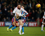 John Brayford of Sheffield Utd clears the ball away from Tommy Rowe of Scunthorpe Utd - English League One - Scunthorpe Utd vs Sheffield Utd - Glandford Park Stadium - Scunthorpe - England - 19th December 2015 - Pic Simon Bellis/Sportimage