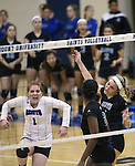 Marymount's Cassidie Watson, Emileigh Rettig and Morgan McAlpin celebrate a point in a college volleyball game against Mary Washington, in Arlington, Vir., on Saturday, Nov. 1, 2014.<br /> Photo by Cathleen Allison
