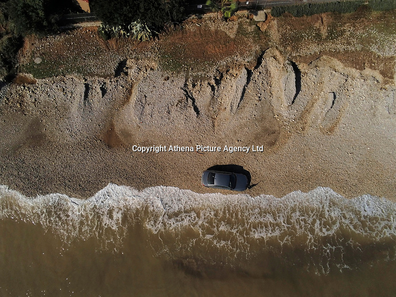 Pictured: A car that was dragged to the beach by heavy rain in the area of Kinetta, near Athens, Greece. Monday 25 November<br /> Re: Heavy overnight rainfall has caused flooding and landslides in parts of Greece.