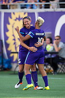 Orlando, Florida - Sunday, May 8, 2016: Orlando Pride midfielder Lianne Sanderson (10) celebrates her goal with defender Laura Alleway (5) during a National Women's Soccer League match between Orlando Pride and Seattle Reign FC at Camping World Stadium. The goal gave the Pride a 2-0 victory.