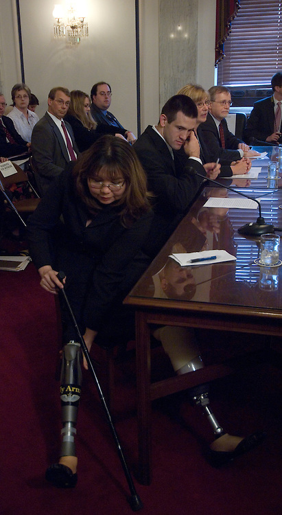 "Tammy Duckworth, director of the Illinois Department of Veterans Affairs gets into her seat before the start of the Senate Veterans Affairs Committee VA-Defense Department Healthcare Cooperation Full committee hearing on ""VA-Defense Department Cooperation and Collaboration - Healthcare Issues.""."